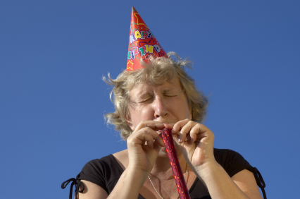 woman with noisemaker on the party