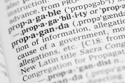 Macro image of dictionary definition of propaganda