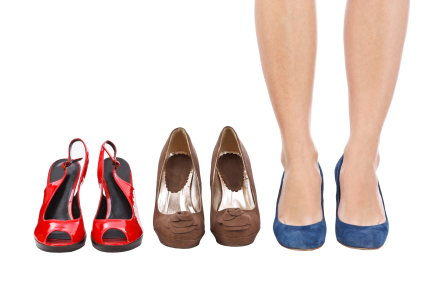 woman choosing shoes concept