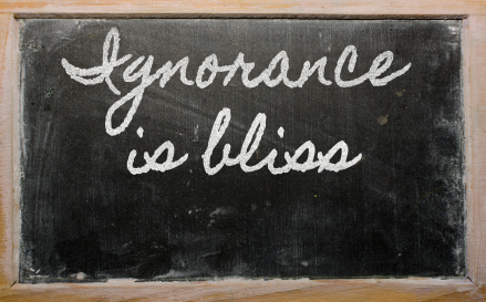 expression -  Ignorance is bliss - written on a school blackboar