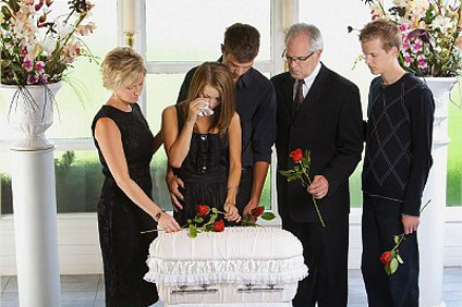 Grieving family with an infant's coffin
