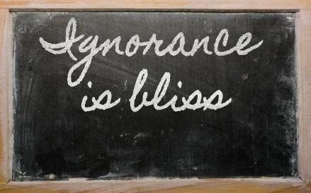 expression -  Ignorance is bliss - written on a school blackboar