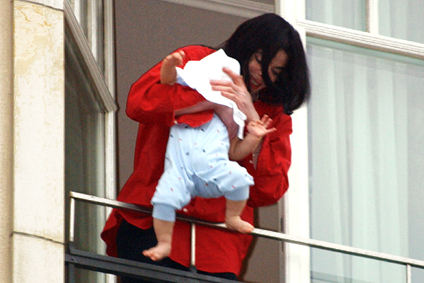 Michael Jackson dangling baby