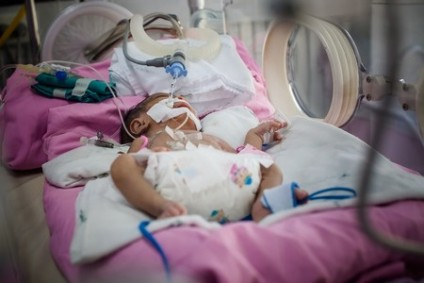 Another unassisted birth, another brain damaged baby