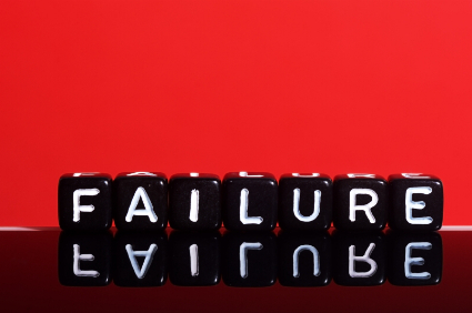 Failure   text  written  on black  cubes on red  background