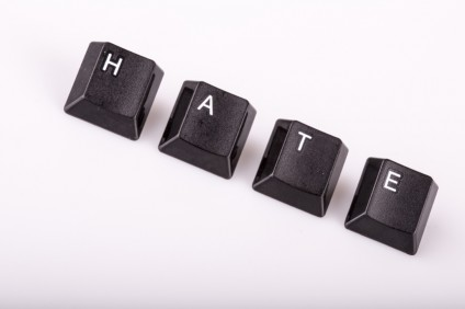 text hate formed with computer keyboard keys on white background