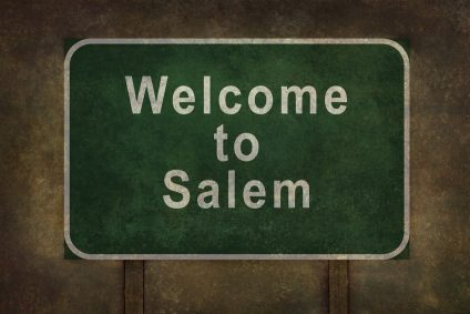 Welcome to Salem road sign illustration, with distressed foreboding background