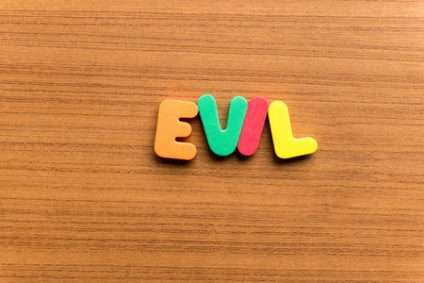 60762669 - evil colorful word on the wooden background