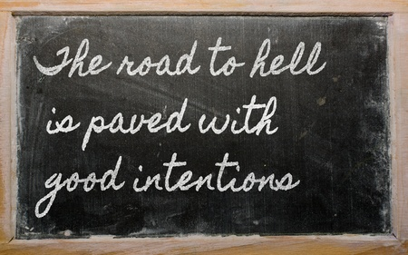 12500335 - handwriting blackboard writings - the road to hell is paved with good intentions
