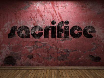 56278157 - sacrifice word on red wall