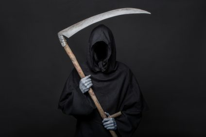 Halloween image of the death reaper on a black background