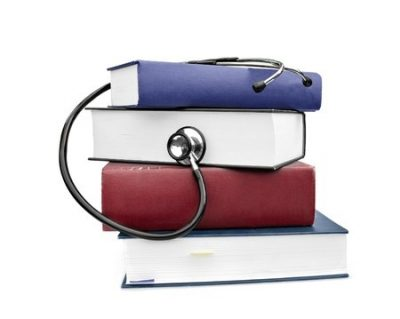 7515470 - medicine and health books with stethoscope isolated on white