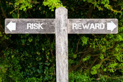 RISK versus REWARD directional signs