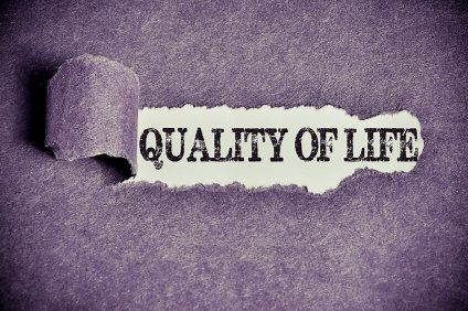 quality of life word under torn black sugar paper