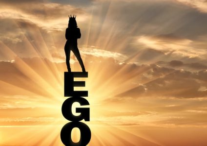 Silhouette of a narcissistic and selfish woman with a crown on her head standing on the word ego