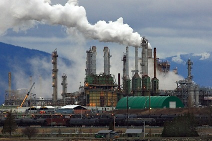 Smoke Billows from Oil Refinery Chimneys