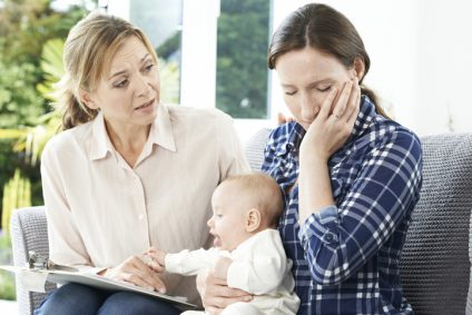 Health Visitor With New Mother Suffering With Depression