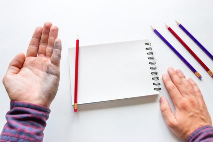 Left-handed man shows a dirty hand after writing mockup