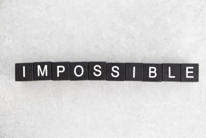 Black cubes with word IMPOSSIBLE on light background