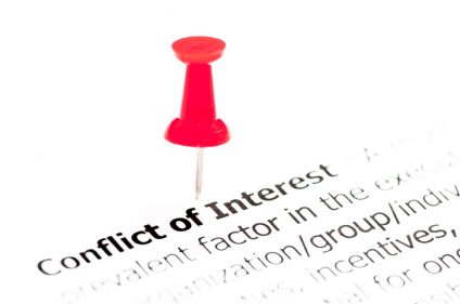 Closeup shot over words Conflict of Interest on paper