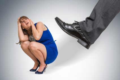 Shocked small business woman under boss pressure