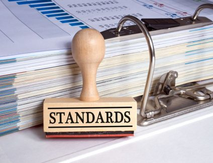 Standards stamp with binder in the office