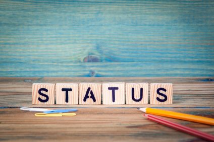 status - name from wooden letters. Office desk, informative and