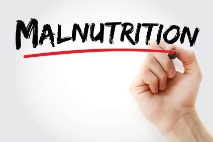 Malnutrition text with marker, concept background