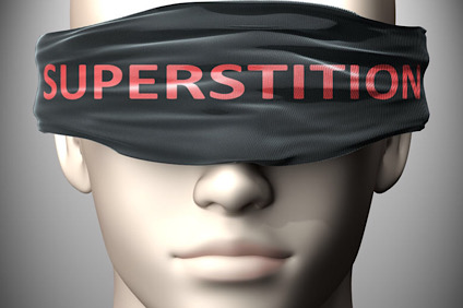 Superstition can make us blind - pictured as word Superstition on a blindfold to symbolize that it can cloud perception, 3d illustration