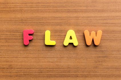 flaw colorful word on the wooden background