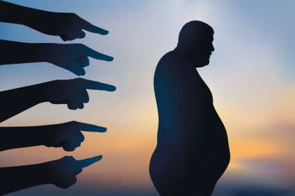 Concept of discrimination with an obese man pointed the finger for his overweight.